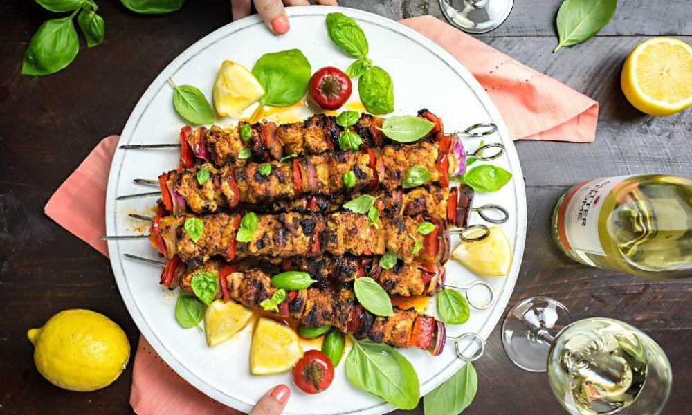 Spicy Italian-Style Chicken Skewers made with roasted peppers, fresh herbs, and served with a Sutter Home Moscato wine!