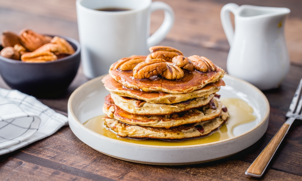 A power packed breakfast that's made in just 15 minutes. Combine pecan pieces, bananas, rolled oats, protein powder and cinnamon for protein pancakes that are made even more nutritious with pecan halves on top.