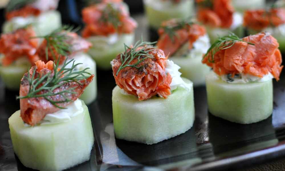 A refreshing twist on the traditional bagel and lox, these smoked salmon bites are served on a hollowed out piece of fresh cucumber! They're light enough to serve on a hot summer day and still packed full of flavor.
