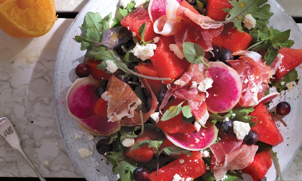 This light and delicious salad, shared courtesy of Cambria Style 2018 Summer Issue (on stands now), incorporates fresh watermelon, blueberries and watermelon radishes, served on a bed of baby greens and topped with prosciutto and feta cheese.