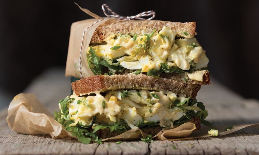 Made just for 2, this isn't your grandmother's egg salad. It includes a homemade mayonnaise that brings the sandwich together in a handcrafted and unique way. The egg salad shines with flavor influences from chives, fennel and lemon zest, served on toasted country-style bread. Enjoy!