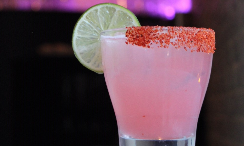 Unlike a classic Paloma, the Paloma Escobar uses a citrus and spice rim to balance the acidity of the fresh lime and grapefruit juice. The introduction of simple syrup further rounds out the flavors of the fresh juices.