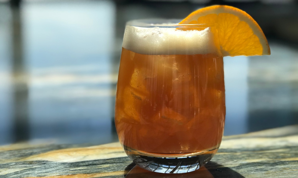 Made with lemon and orange citrus juice, a housemade rooibos syrup, Makers Mark, and seltzer, this cocktail is tangy and perfectly sweet!