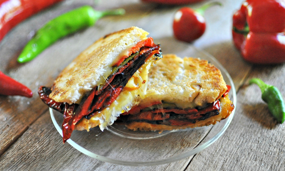 The bumper crop of peppers – hot, sweet and mild – calls for recipes that make good use of this incredible crop, like this Smoky Pepper sandwich, which you can create using your own farm-fresh peppers!
