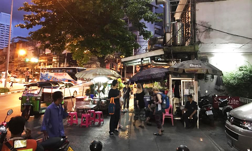 A shot of an outdoor cafe serving street foods in Bangkok, Thailand.