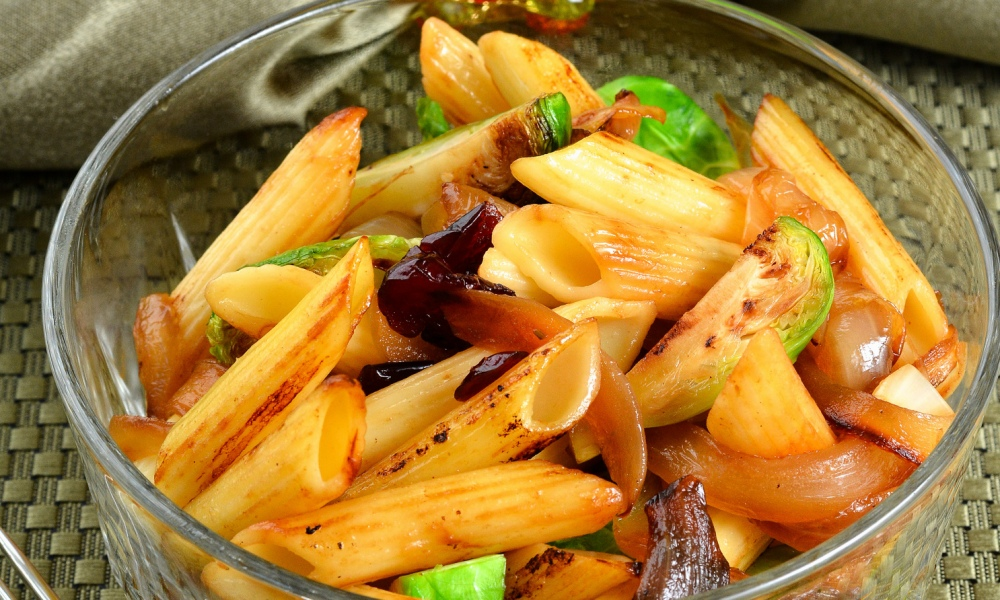 Embrace the flavors of Thanksgiving with this recipe for Brussels Sprouts, Dried Cranberries, Caramelized Onion and a festive Sage Penne pasta.