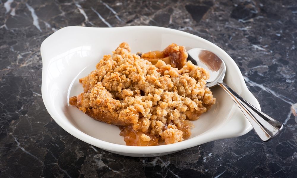 After all the Hannah Swenson novels we've read, we like to think we know all the characters. This recipe for Honey Apple Crisp, from Christmas Cake Murder, gives us the chance to showcase her sister, Michelle's, baking prowess.
