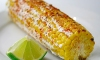 From celebrity caterer Andrea Correale, Founder and President of Elegant Affairs, this tailgate favorite, Cotija Mexican Corn. Lightly charred corn, rolled in melted butter, covered with mayonnaise and topped with cotija cheese and lime wedges.