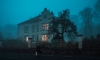 A person approaches a haunted house, the perfect setting for a Halloween celebration with Zach Neil's new cookbook, The Nightmare Before Dinner.