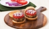 Lamb with bread crumbs, oregano, cumin, coriander, milk, eggs, salt, pepper and onions, crafted into slider-side patties, topped with feta cheese and served on slider buns.