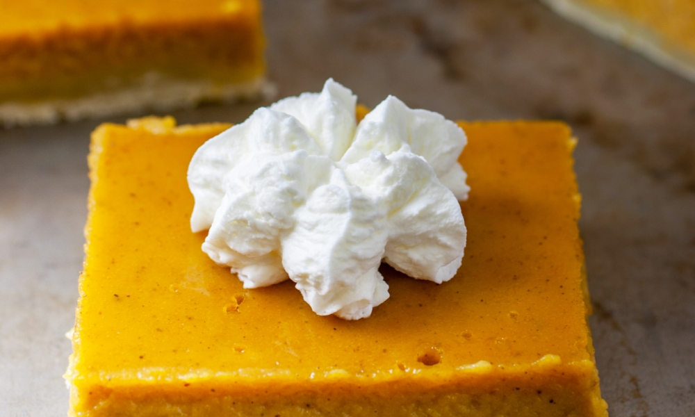 The average slice of pumpkin pie can weigh in at 350 calories and 13 grams of fat. These Light Pumpkin Pie Squares get their body from lite organic tofu and weigh in at about half the calories with about 3 grams of fat.