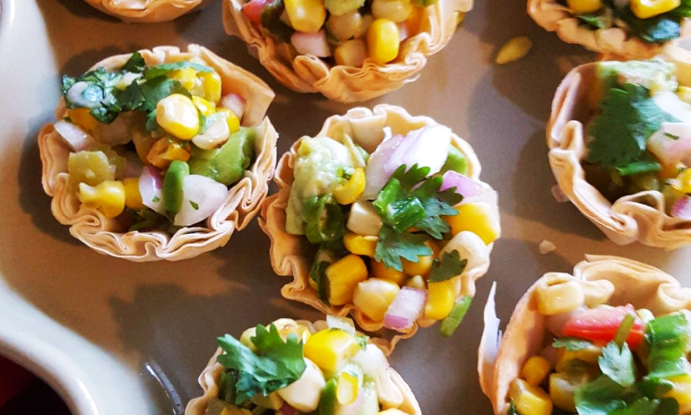 Late summer bounty from the garden is always a delight to use and share with friends and family.This quick appetizer, or small bite, is on trend and beautiful with south of the border flavors.