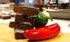A stack of freshly baked chocolate brownies, made with Rio Luna organic peppers.