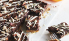 A seasonal twist on one of our favorite brownie recipes at the Seasoned Cookery School. Spiced Fig Brownies are ideal for the festive holidays. These craveable little bites are filled with figs, spices and orange with the addition of a biscuit layer on the bottom.