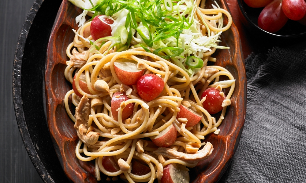 This Asian Noodle Salad with Chicken and Grapes combines savory and sweet with the addition of succulent California grapes.