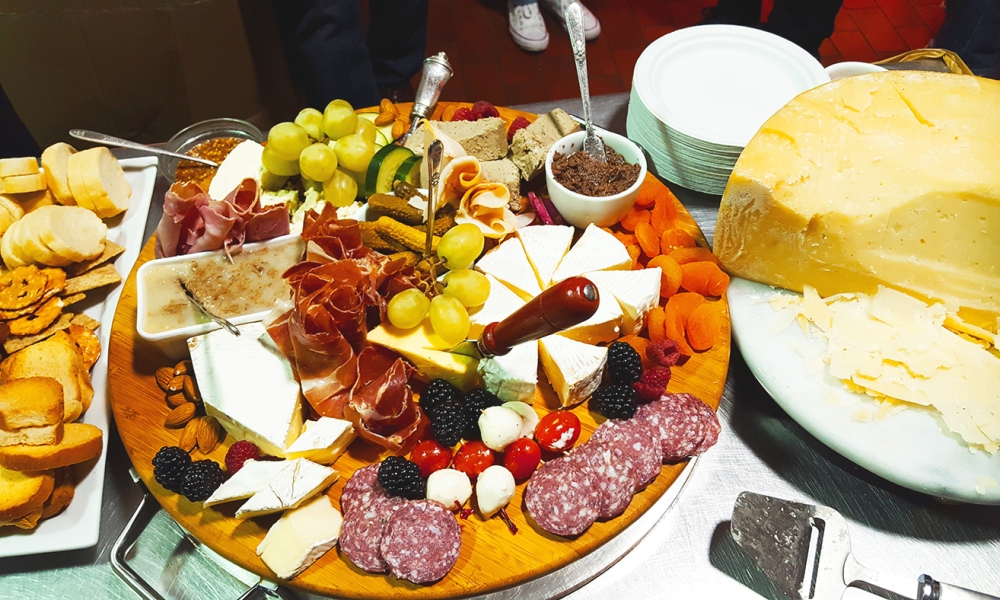 A holiday charcuterie board is easier to make than you think. Provide a simple selection of meets, cheese, fruits, olives and spreads that appeal to a variety of tastes.