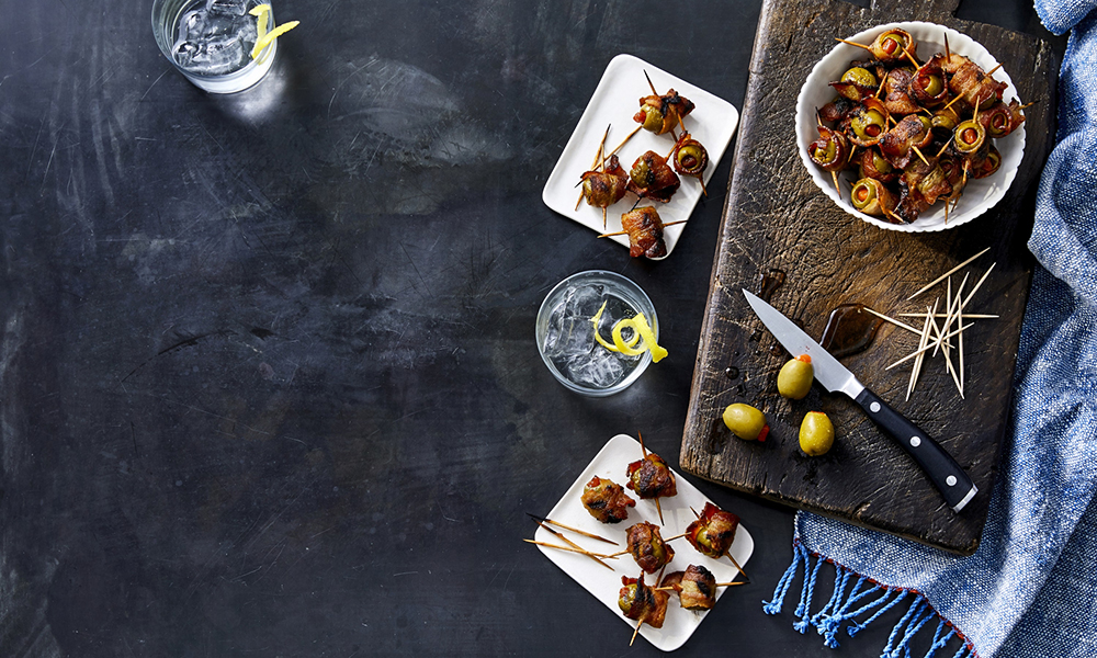 These bacon-wrapped olives are simple to make and the perfect combination of classy meets country. From Martina McBride's new cookbook, My Kitchen Mix.