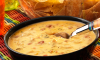 Looking for that perfect Queso Dip for your football watch party? Look no further. This recipe from Campbell's couldn't be easier. It's made with the company's Chunky Spicy Chicken Quesadilla Soup—2 ingredients and 3 minutes on the stove and you're ready to dip your way through the game!