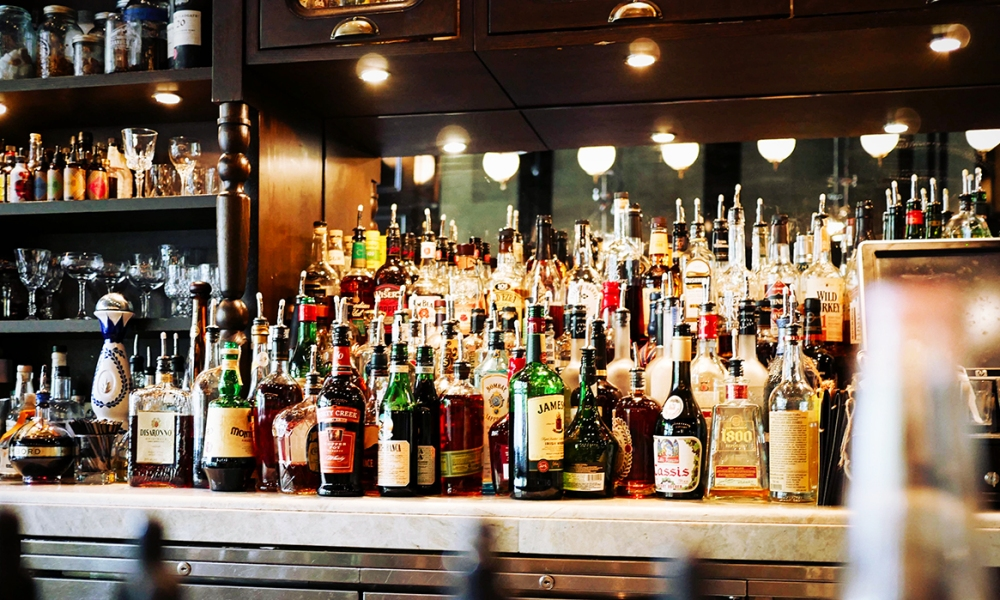 A variety of alcohol at a full bar.