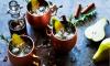 This pear-y twist on the classic Moscow Mule cocktail—with the warming effects of ginger and cinnamon, and the scent of fresh rosemary—is the perfect party starter.