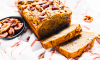 This recipe for Pecan Banana Bread puts a delicious twist on this classic breakfast dish with pecans. Simply combine pecan pieces into the mix and sprinkle additional on top for a flavorful crunch that can be made ahead of time for a weekday morning or if entertaining guests.