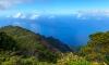 A photo of a breathtaking view of the bright blue sky from a mountaintop in Hawaii.