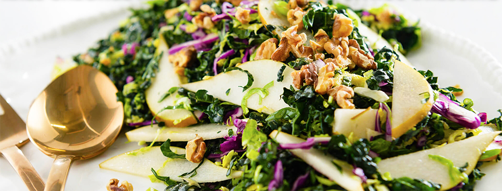 Here is a quick fruit and vegetable salad with a sweet and tangy dressing. This Kale Cabbage and Pear Salad with Citrus Dressing makes an ideal side for grilled fish or chicken, but also pairs well with roasted meats. This recipe is perfect for slightly under-ripe pears—they add a unique texture and flavor to this colorful salad.