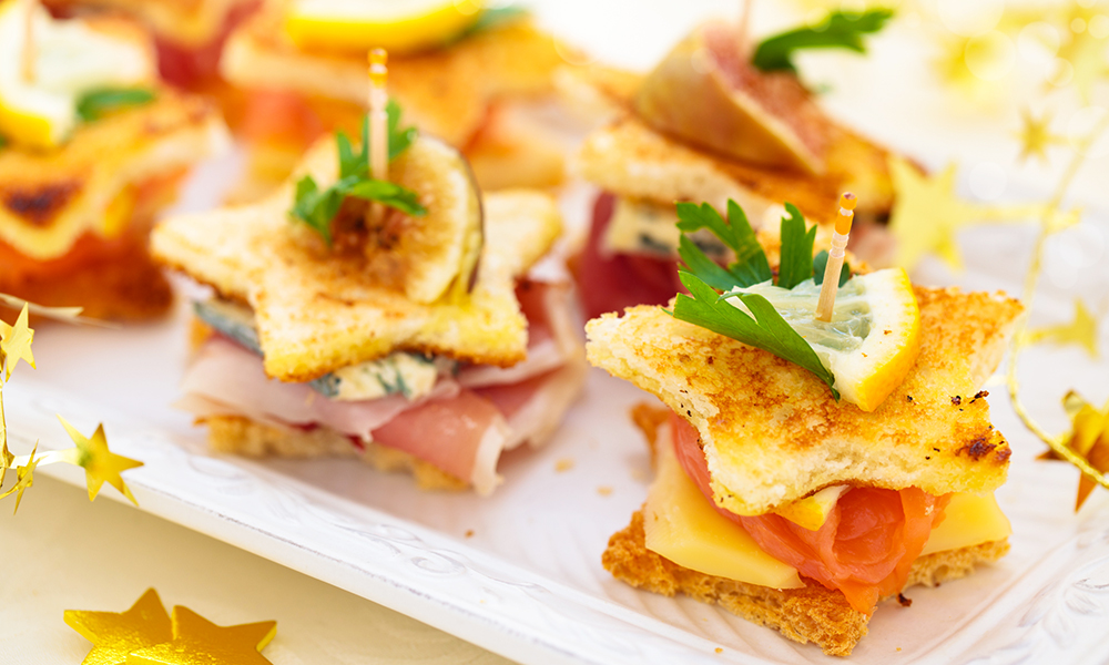 Hooray for Hollywood! You'll be the star of your Oscar® watch party with these Star-Shaped Mini Club Canapés crafted by caterer-to-the-stars Andrea Correale!