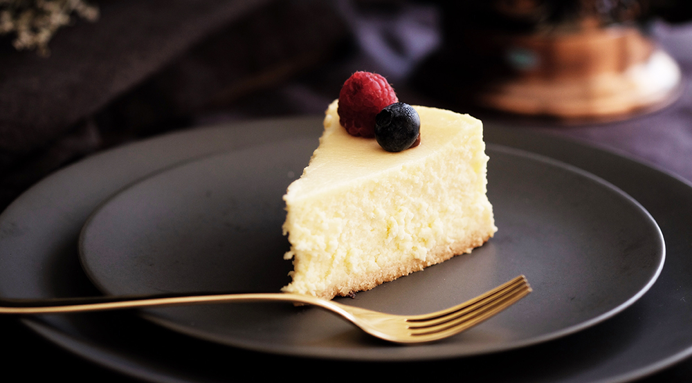 It's as close to New York style cheesecake as we've ever had from a homemade cheesecake—and the secret is a touch of cream and a little extra time in the oven. This is the recipe that will take the fear out of making cheesecake at home. You don't even need a Springform pan!
