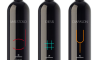 A trio of wine bottles reflective of contemporary graphic design to best convey a company's brand image and story.