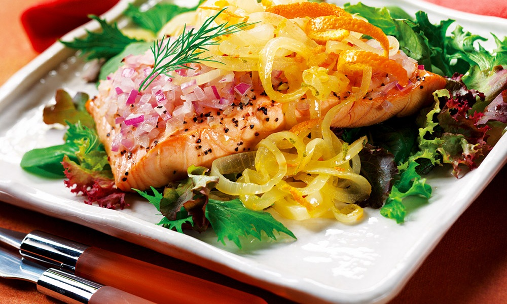 A delicious, light and flavorful Chilled Salmon Salad with Orange Citrus Onions. Salmon with red and yellow onions, dry white wine, granted lime and orange peels, and orange juice, served on a bed of dark, leafy mixed salad greens.