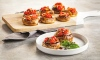 Bruschetta is a colorful and delicious appetizer for any gathering. For a lower-carb option, try this simple bruschetta stuffed in mushrooms instead of serving on the traditional baguette.